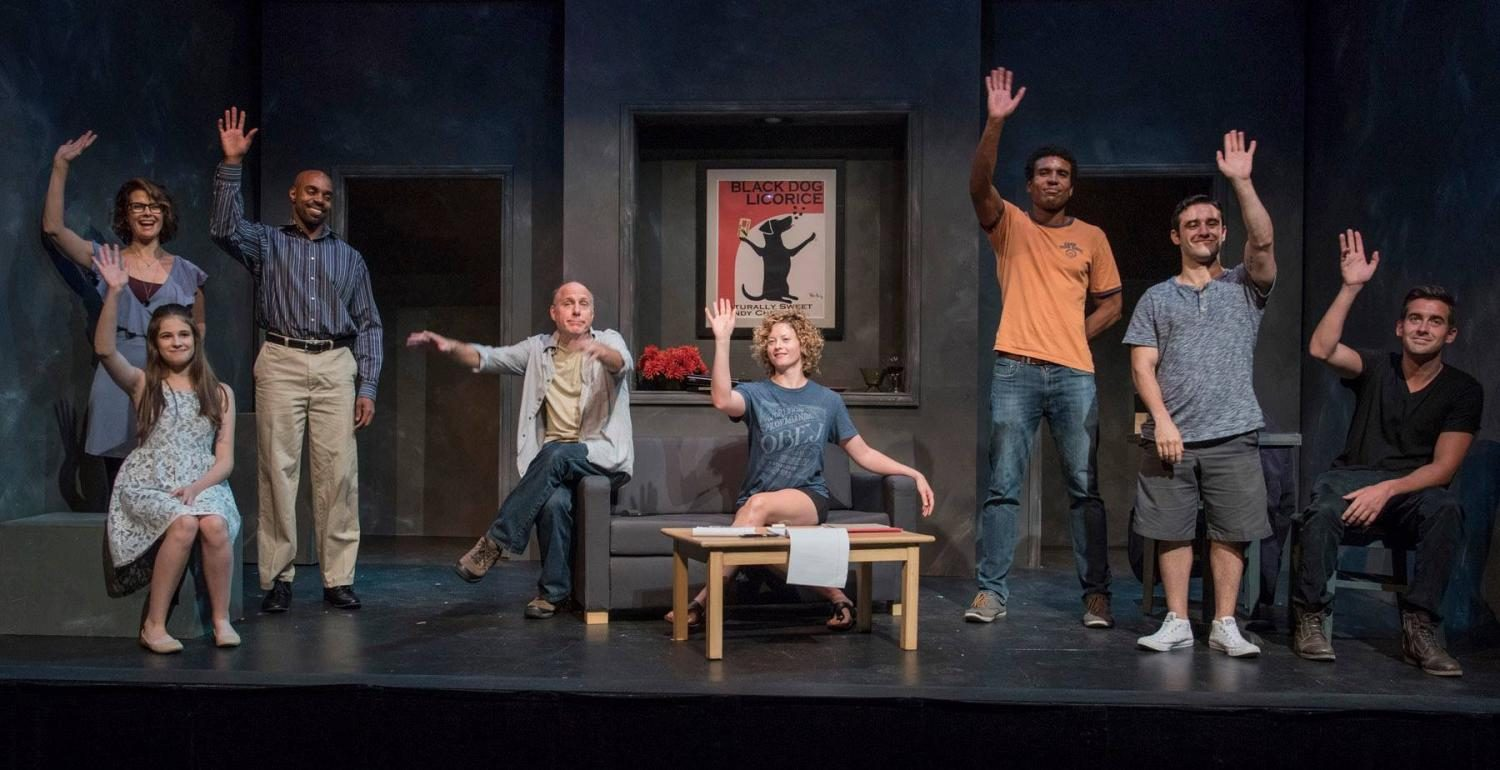 Cast on stage during the play.