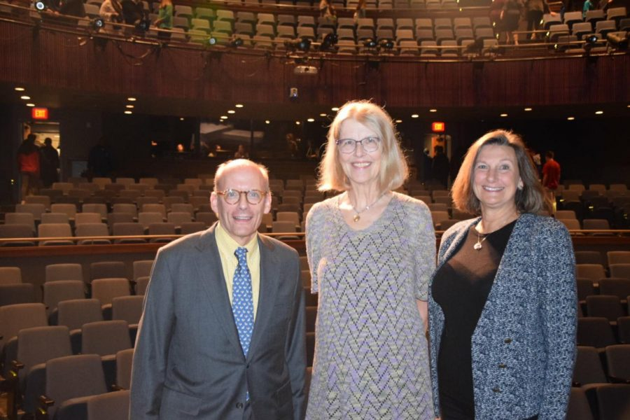 Jane Smiley '67 poses with president Tom Kahn '71 (left) and Beth Louis '72 (right) after the Alumni Awards assembly.