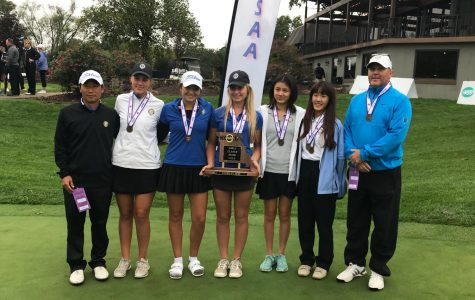 Lucy Bloomstran, 19', holds the 3rd place trophy as the Women's Varsity Golf teams smiles for a picture after an exciting state tournament.