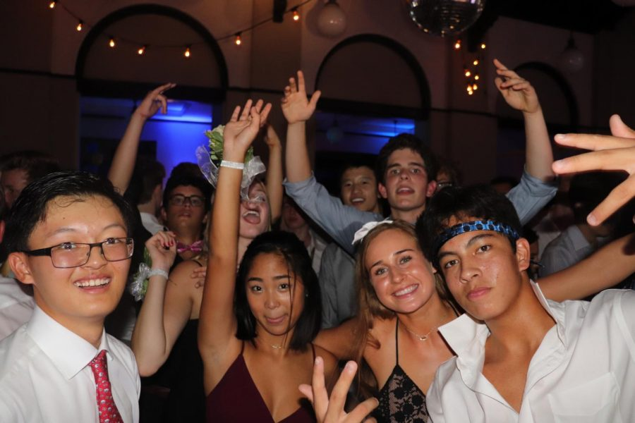 Juniors pause from dancing to smile for a picture.